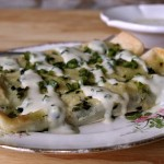Black Bean, Bacon and Spinach Enchiladas with Roasted Poblano Bechamel